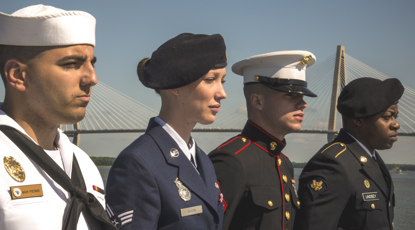 Servicemembers from four military branches in uniform.